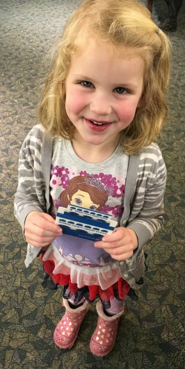 Gracie with her first Library CArd