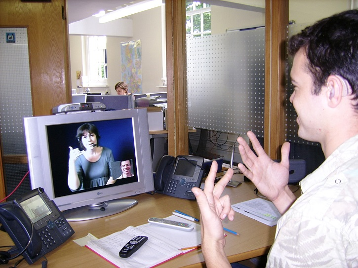 Two people video chatting on their computers - Stay In Touch With Loved Ones