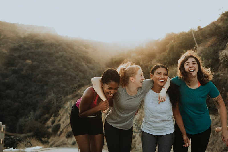 4 young women taking a walk - 8 Ways to Keep the Stress at Bay