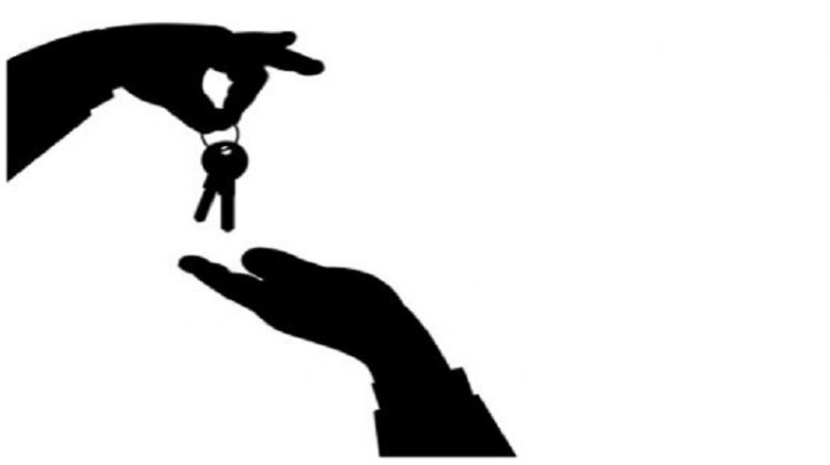 Silhouette of hand with keys placing into another hand