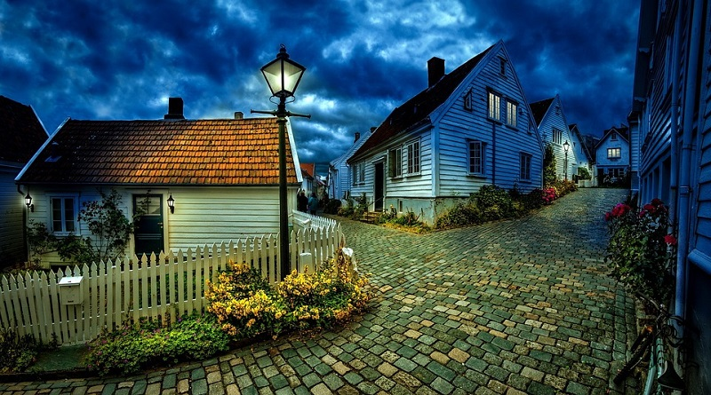 Little Houses at Dusk on a Cobble Stone Road
