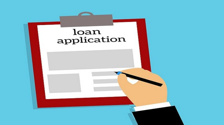 Loan Application on Clipboard Why You Might Need a Small Loan