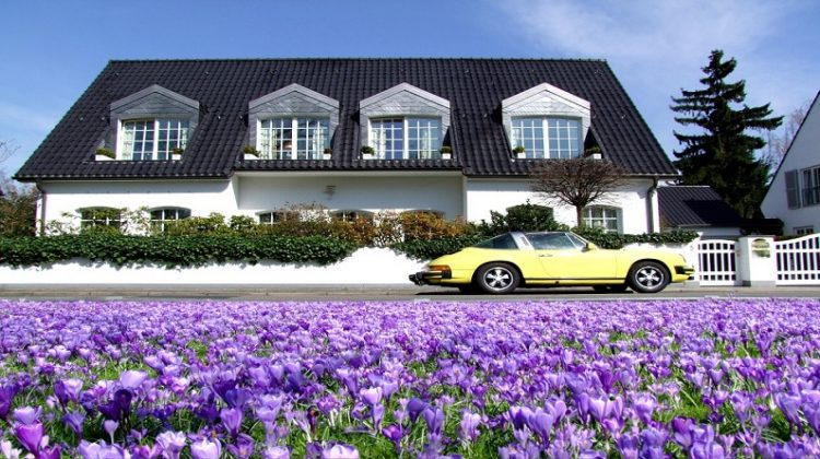 Lovely Villa with Beautiful Purple Flowers and a Yellow Sports Car in the Front