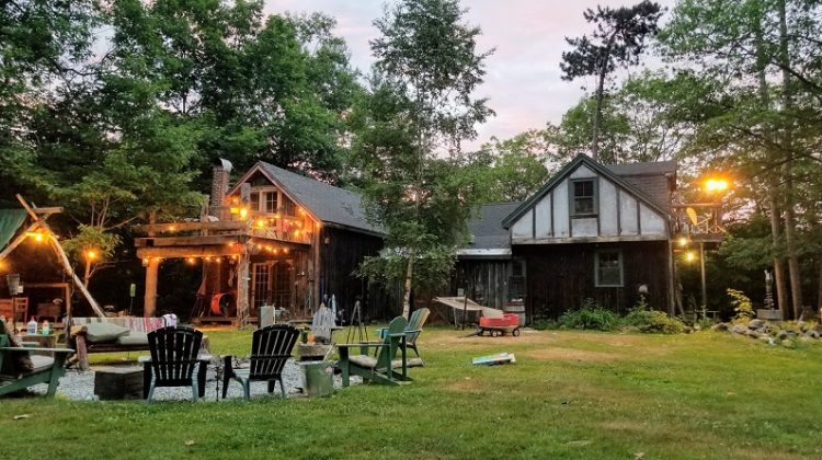 Backyard at Dusk w/ Adirondack Chairs, Hanging Lights and Fire Pit - Summer Backyard Essentials