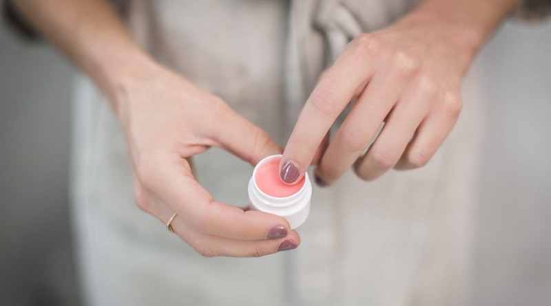 Woman holding small jar of eye cream - Eye Creams: They Help you Look Younger as You Age