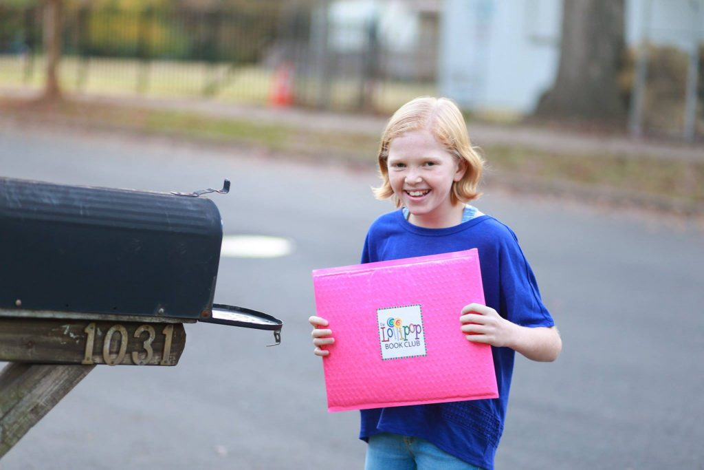 Child at Mailbox with Package from The Lollipop Book Club - Put a Smile on Your Child's Face with The Lollipop Book Club