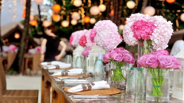 Beautiful Wedding Reception Table, with Pink Floral Arrangements - How to Find the Perfect Wedding Venue
