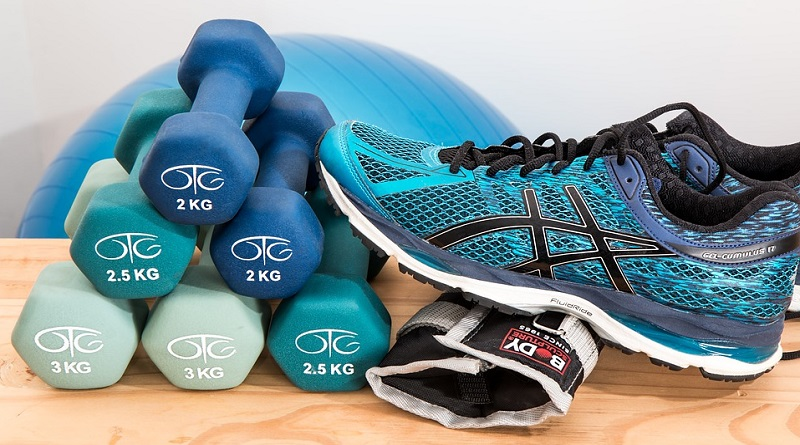 Dumbells and workout shoes - Workout Essentials To Make Exercise Easier