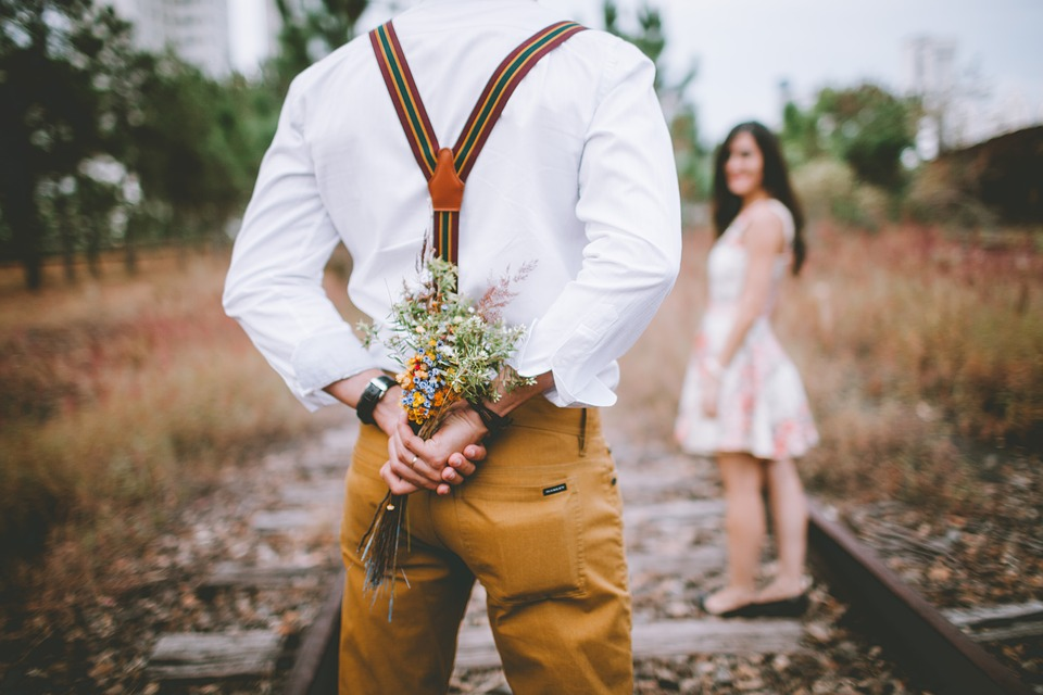 Groom in khaki pants with suspenders - 6 Ideal Styles for the Perfect Groom