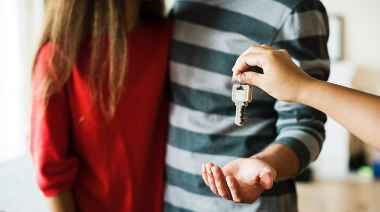 Handing House Keys to Couple - 4 Things You Need To Fix Before You Sell Your House