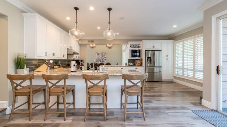 Kitchen with Stainless Steel Appliances and Bar with Brown Wooden Chairs - 5 Steps When You No Longer Like Your Home