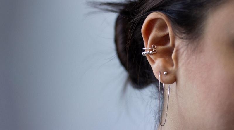 Woman's ear with multiple piercings -The Cutest Ear Piercings