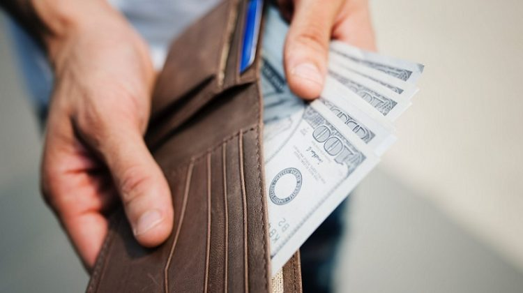 Wallet filled with $100 Bills -Thinking About Loaning Money to a Friend? 8 Reasons Why You Should NOT