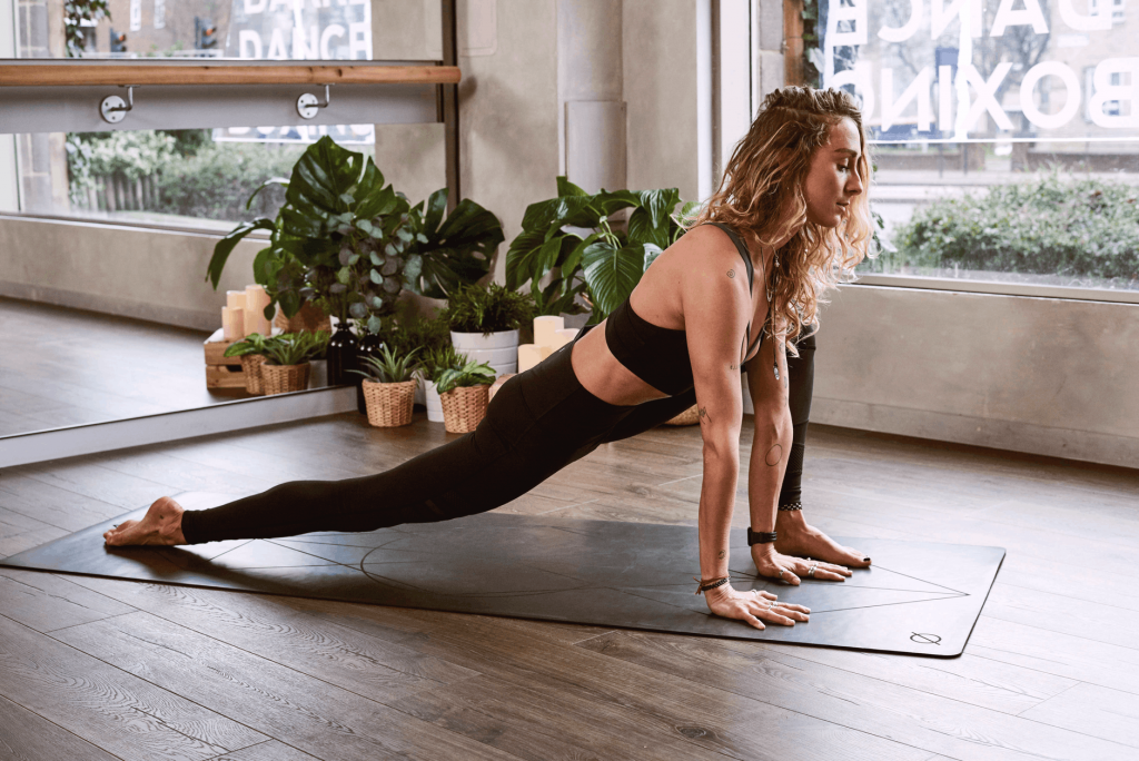 Woman doing Yoga - 6 Family-Friendly Fitness Tools Every Home Should Have