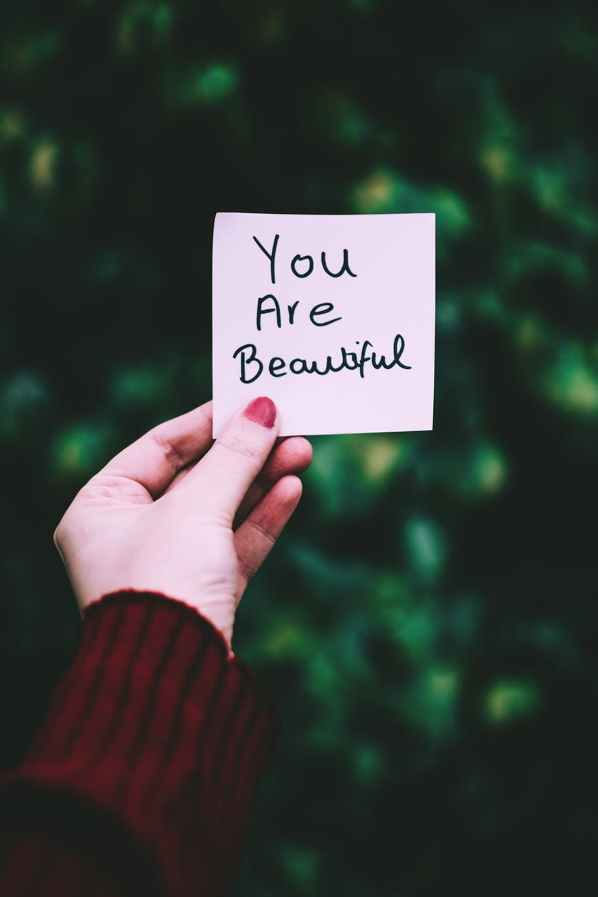 Woman Holding Note that Says You Are Beautiful -  Six Ways To Love Your Body More
