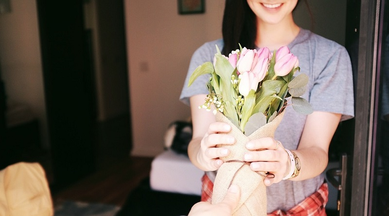 Woman receiving a bouquet of flowers - Best Gifts for A Business Lady