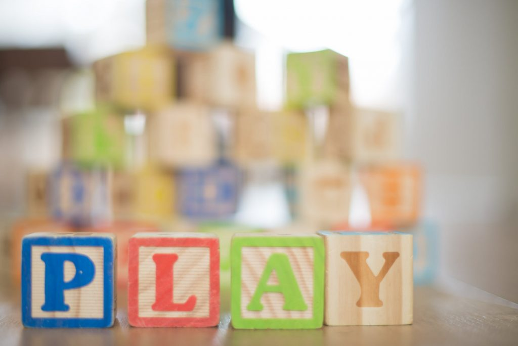 Wooden Blocks spelling the word PLAY - Tips for Long-term Success of Your Child Care Business