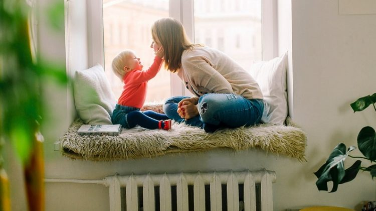 Mother and Child in Window Seat - Make Your Home Safer