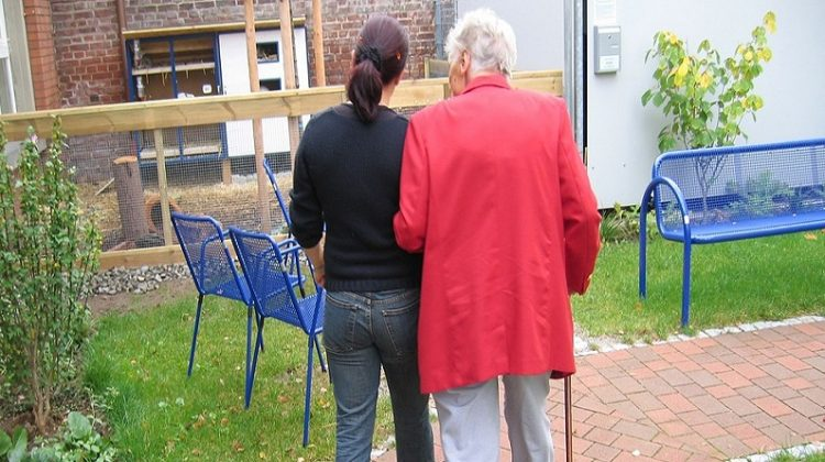 Older and Younger Woman Walking Together - Caregiver Burnout