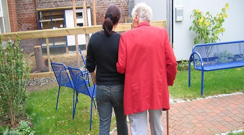 Older and Younger Woman Walking Together - Caregiver Burnout