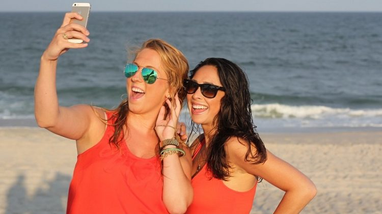 Two Girls on Beach taking a Selfie - How To Perfect Your Sizzling Selfies
