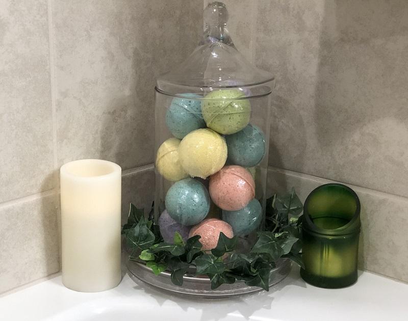 Bath Bombs in a glass jar in the corner of a bathtub - Steve's Goods