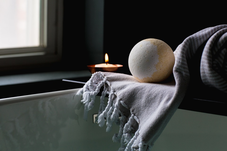 Bath Bomb and Candle beside Bathtub - Pamper Yourself