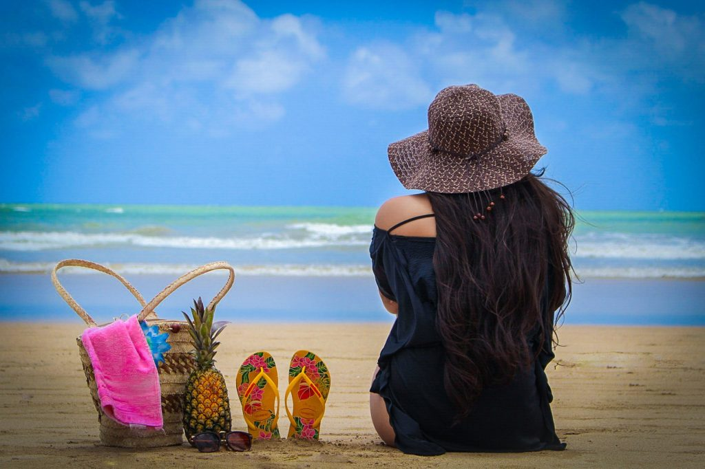 Lady on beach with beach bag - Beach Vacations