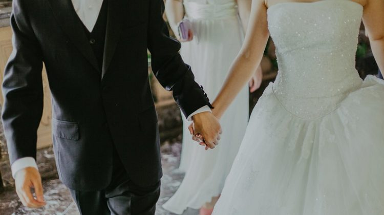 Bride and Groom Holding Hands - Wedding Essentials