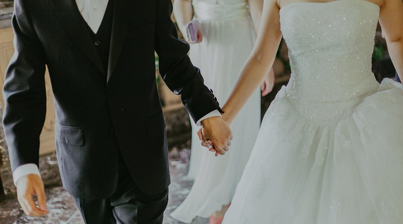 Bride and Groom Holding Hands - Wedding Essentials