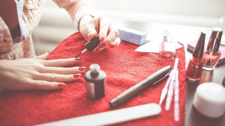 Woman doing her nails - Boost Your Beauty Routine Without Visiting the Salon with These At-Home Treatments
