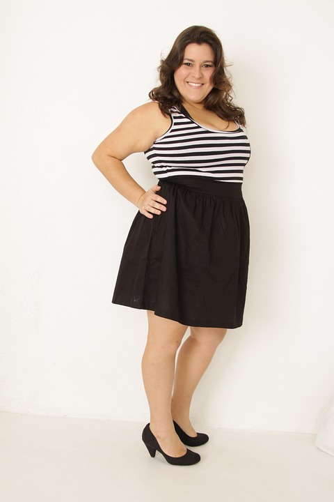 Woman in a a black and white stripe sleeveless top and black skirt - Love The Skin You Are In