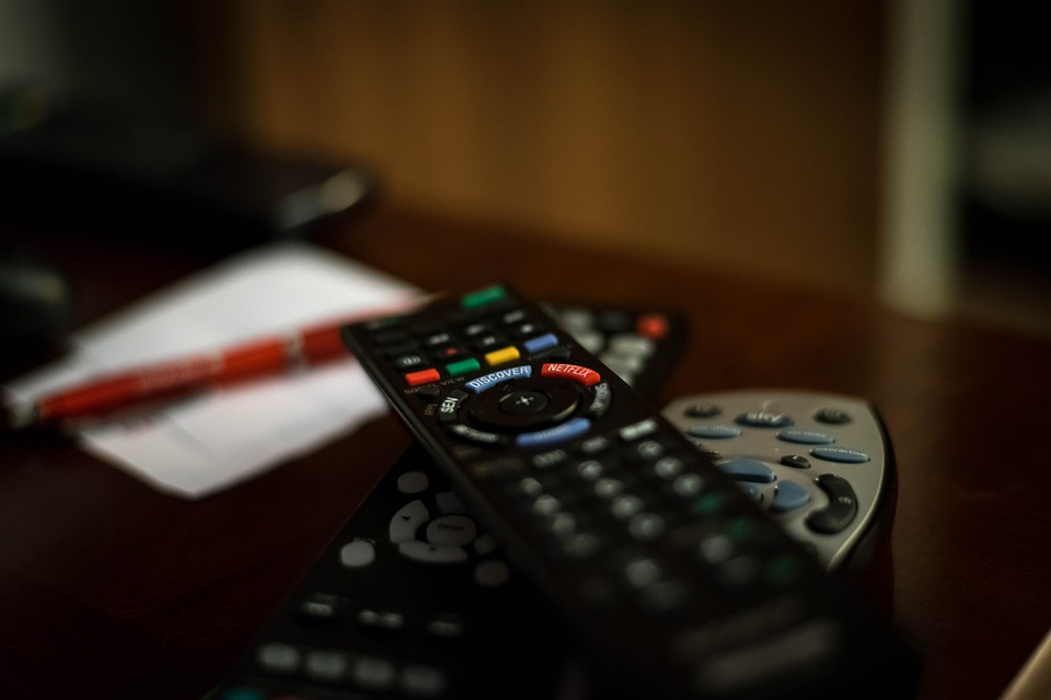 Remote Controls on Table - Things In Your Home You Aren't Cleaning Often Enough