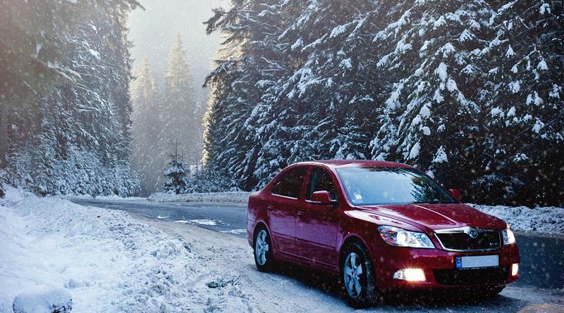 Car on Snowy Winter Road