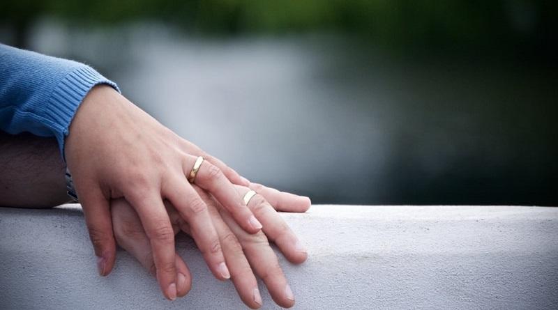 Husband's Hand on Top of Wife's Hand - Husband