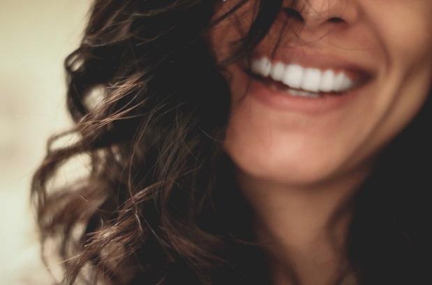 Smiling Brunette - too old for braces