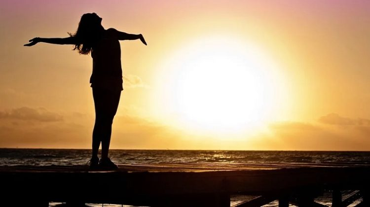 Woman on Pier at Sunset - Learning To Love The Person That You Are