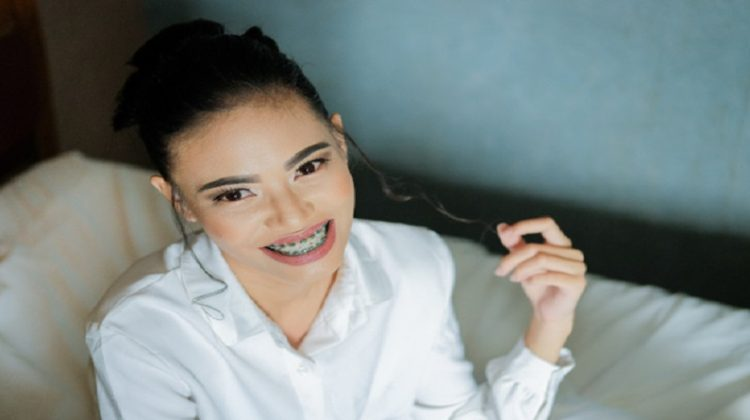 Smiling woman with braces -