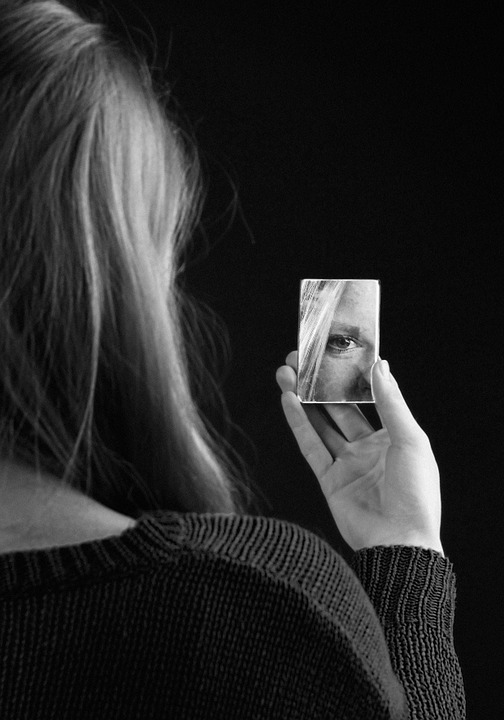 Woman looking into mirror - The Person That You Are