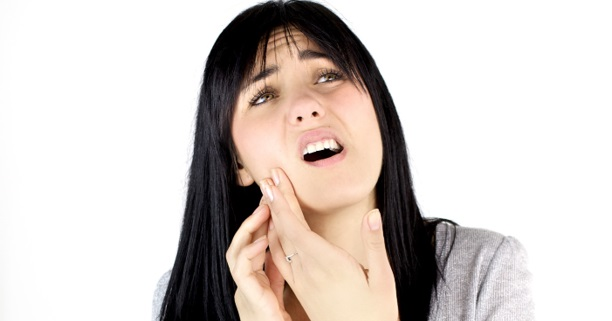 Woman with jaw Pain - Braces