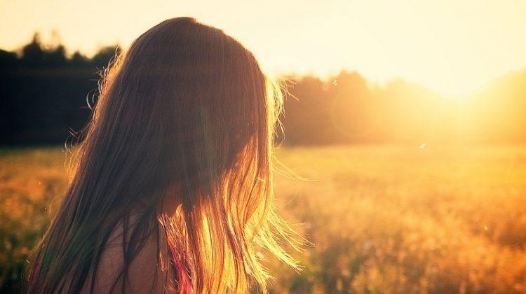 Woman in a field in the sunshine - Inner Beauty