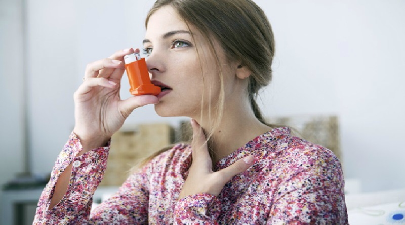 Woman Using Inhaler - How to Control Asthma on the Go