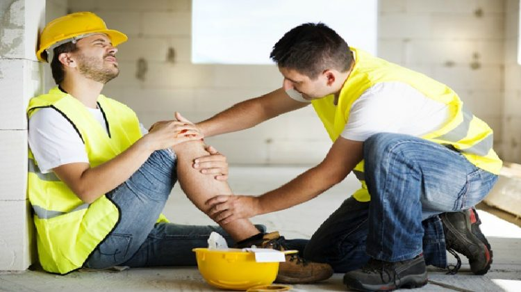 Injured Man in Hardhat - 5 Important Things to Do When You Get an Injury at Work