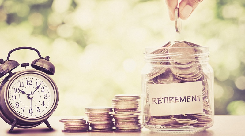 Alarm Clock and Jar with Coins -Why It's Never Too Early to Think About Retirement