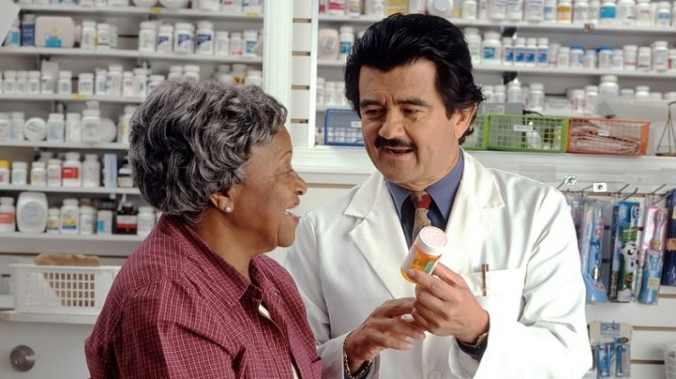 Woman Consults with Pharmacist - Human Error at any Pharmacy