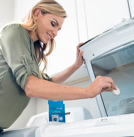 Woman Cleaning Washing Machine - Laundry Tips for Every Homeowner