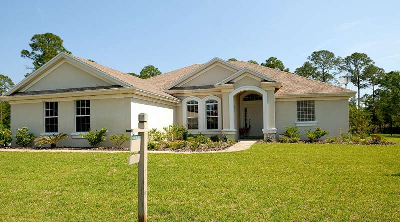 Beige and White Home with For Sale Sign - Fixing Curb Appeal Problems