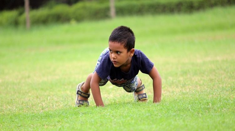 Little Boy on Grass - Helping Your Children Overcome Common Difficulties