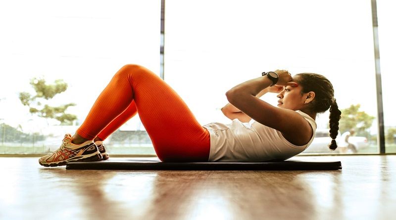 Woman doing sit-ups - Create the Best Workout Space at Home