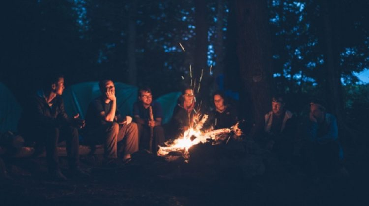 Group of Friends Around a Camp Fire - Make the Most of a Camping Adventure